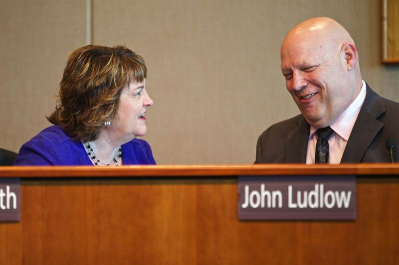 by: PHOTO BY JAIME VALDEZ - Clackamas County Commissioner Tootie Smith talks with Chair John Ludlow before a recent Commissioners' Business Meeting.