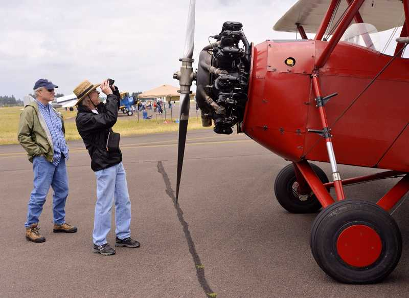 Jay Newman, left, and Bob Cole, both of Portland, go over every detail of a 1929 New Standard bi-lane at the Warbirds of the West air show Saturday. Both are aviation enthusiasts and are especially interested in the mechanics of vintage airplanes. 'We're old enough to appreciate the old things,' Cole said.