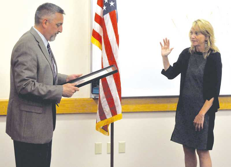 by: SETH GORDON - It's official - Jacque Betz was sworn in as Newberg's next city manager at the City Council meeting Monday evening.