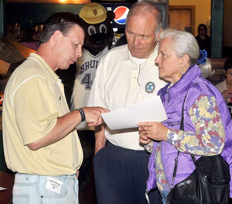 by: SETH GORDON - Mingling - Newberg residents Mike Clock and Cheryl Dailey chat with George Fox head football coach Chris Casey during a meet-and-greet event Friday at Abby's Pizza. The Bruins are hoping for a full house when they end their 45-year football hiatus Sept. 6.