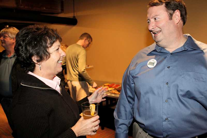 by: FILE PHOTO - Tigard Mayor John L. Cook, right, chats with supporters after his 2012 win. Cook was elected in a special election to fill the remainder of Craig Dirksen's term. Cook has filed to run for his first full term this fall.