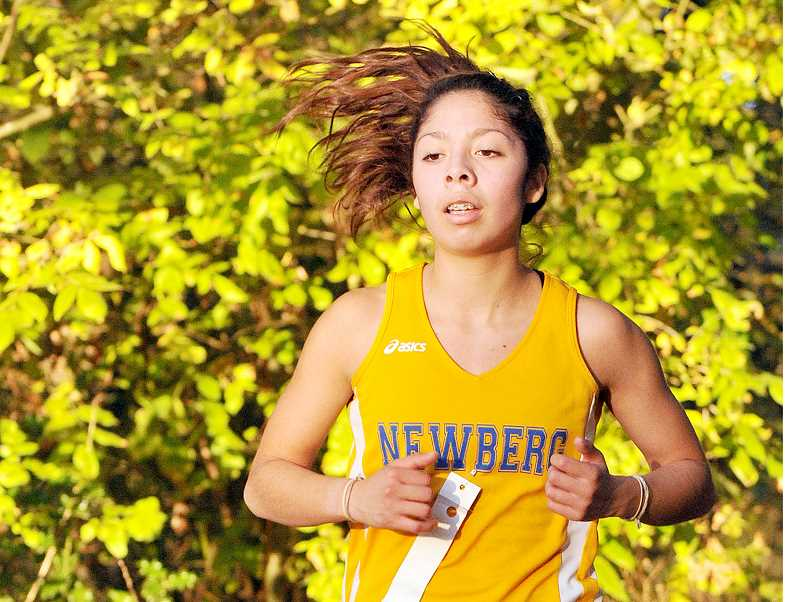 by: SETH GORDON - Competing schools - Debora De Leon will run cross country and track for Western Oregon University, not far from her sister Rebeca, who will compete for Linfield College.