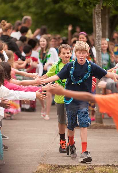 by: SPOKESMAN PHOTO: JOSH KULLA - Boones Ferry Primary School fifth-graders George Kraecklow (front) and Logan Carpenter encounter a sea of well-wishers, both fellow students as well as teachers, parents and ambassadors from Wood Middle School.