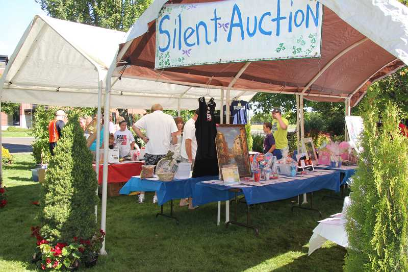 by: SUBMITTED PHOTO - A silent auction is a big part of the Boy Scout fundraiser. This year, a live auction will begin at 9:30 a.m. and run until noon Saturday.