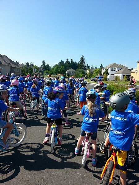 by: SUBMITTED PHOTO - Lowrie Primary School's 479 students took to the streets May 30 for the two-year-old school's second annual Wheel-a-thon.