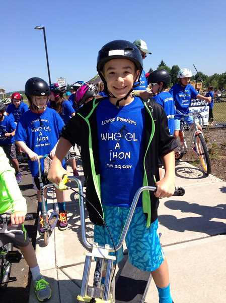 by: SUBMITTED PHOTO - Cruz Saucedo is ready to get his wheels turning at Lowrie Primary School's Wheel-a-thon.