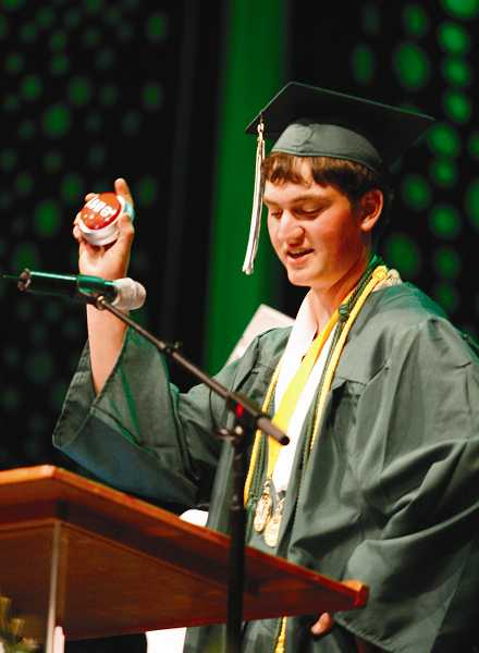 by: PHIL HAWKINS - Co-valedictorian Sid Silbernagel holds up an 'easy' button during his speech.
