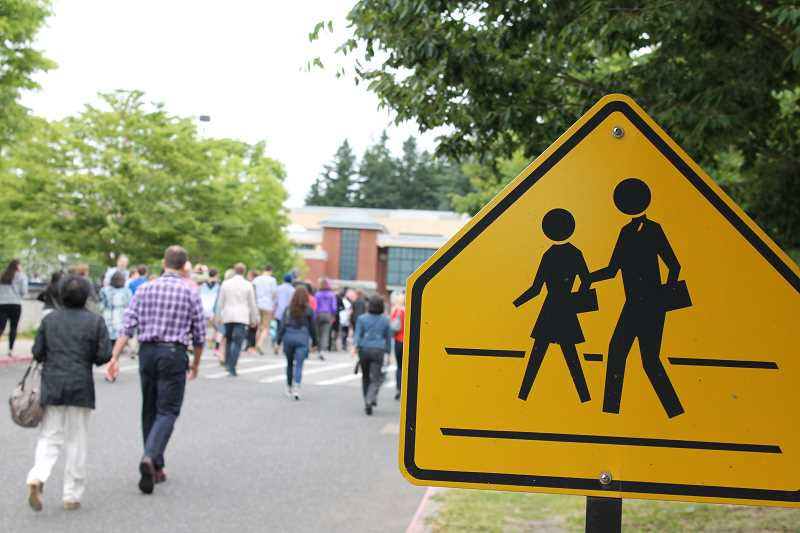 by: THE REVIEW: JILLIAN DALEY - New freshmen and their families headed to Lake Oswego High for an informational assembly following the Balloon Crossing.