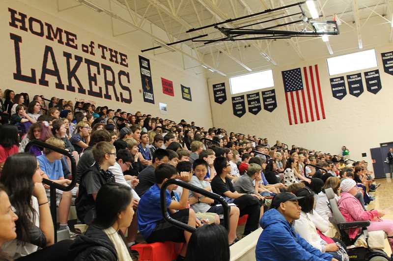 by: REVIEW PHOTO: JILLIAN DALEY - Incoming freshmen packed the bleachers for the post-Balloon Crossing assembly.