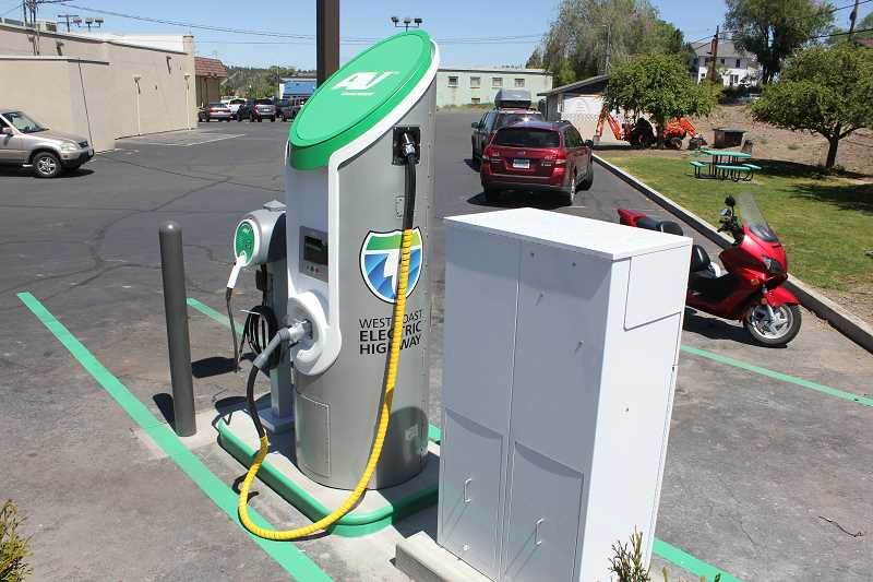by: SUSAN MATHENY - The new electric car charging station, located on the south side of the Dairy Queen parking lot, is part of a regionwide system.