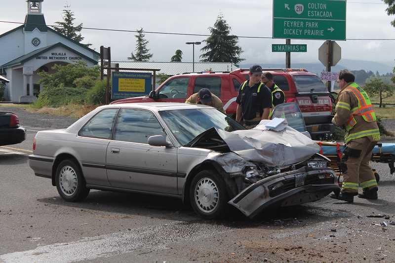 by: JIM BESEDA/MOLALLA PIONEER - A Honda heading into downtown Molalla on Highway 211 crashed into the driver-side of a Dodge Ram 2500 pick-up truck just before 10 a.m. Friday at the Y-intersection at the east end of Main Street.