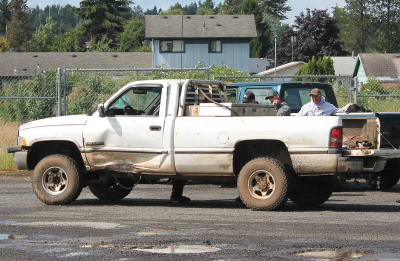 by: JIM BESEDA/MOLALLA PIONEER - Police talk with the driver of this Dodge Ram 2500 pick-up truck that was involved in a two-car crash Friday morning at the Y-intersection near the east end of Main Street in Molalla.