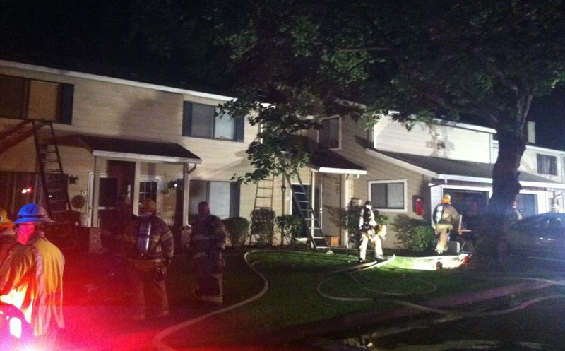by: COURTESY OF TVF&R - Five people were displaces early Saturday morning, June 21, by a fire that damaged two Courtside Drive apartments. A young man helped rush his two younger brothers out of the apartment after a smoke alarm woke him at about 12:30 a.m.