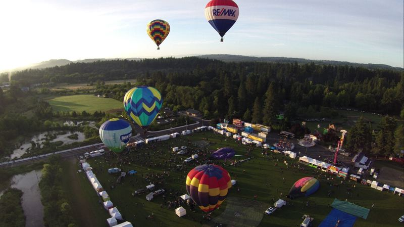 by: COURTESY OF ALVARO FONTAN - Balloons lift off early Saturday morning, June 21, during Tigard's annual Festival of the Balloons.