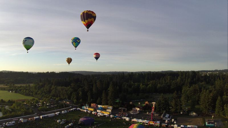 by: COURTESY OF ALVARO FONTAN - Saturday morning's calm weather aided balloon pilots during their flight from Tigard's Cook Park.