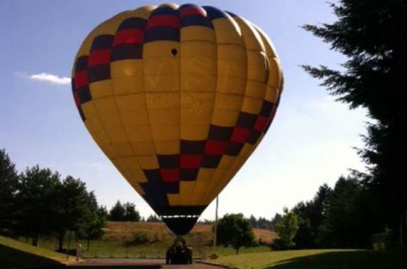 by: KOIN 6 NEWS - A hot air balloon touched down at Coffee Creek Correctional Facility Thursday after a wind gust blew the balloon away from a nearby field and onto prison grounds.