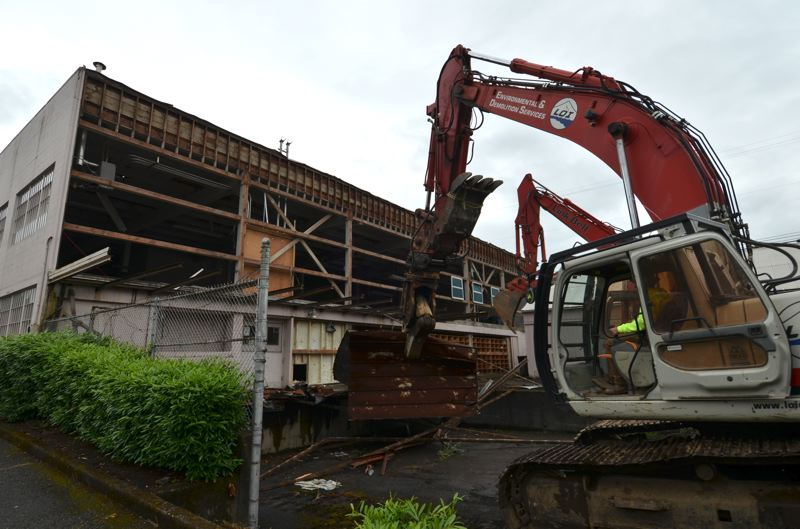 by: COURTESY PROVIDENCE PORTLAND MEDICAL CENTER - Demolition began last week on the Moore Lithograph building in Northeast Portland. Providence Portland Medical Center is replacing it with a new guest housing project.
