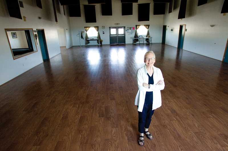 by: KEVIN SPERL - Linda Sawyer stands in the Great Room of the Powell Butte Community Center.