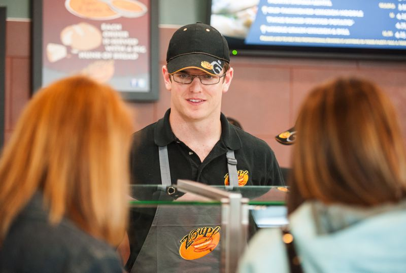 by: SPOKESMAN PHOTO: JOSH KULLA - Zoup! Wilsonville owner Brian Carney works with his staff during a special mock lunch held for the Wilsonville business community last week a day ahead of the stores grand opening on June 19.