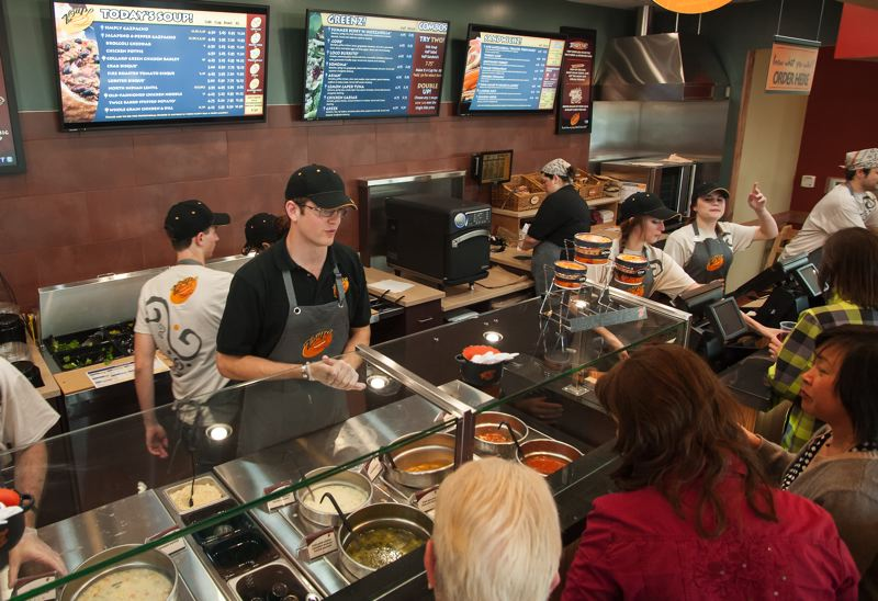by: SPOKESMAN PHOTO: JOSH KULLA - Zoup! Wilsonville owner Brian Carney (in hat and glasses) works with his staff during a special mock lunch held for the Wilsonville business community last week a day ahead of the stores grand opening on June 19.