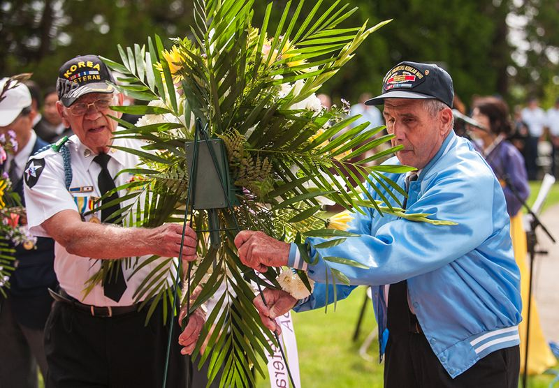 by: SPOKESMAN PHOTO: JOSH KULLA - Korean War Veterans Association – Oregon Trail Chapter President Charles Lusardi (right) helps place a wreath to commemorate the servicemen and women lost in the Korean War.