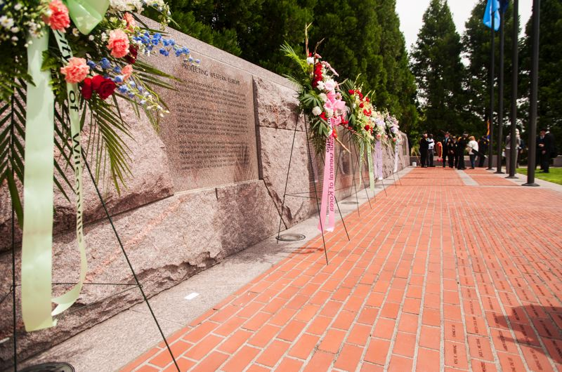 by: SPOKESMAN PHOTO: JOSH KULLA - Wreaths commemorating the dead of the Korean War were placed at Wilsonville's Korean War Memorial at a June 21 ceremony.
