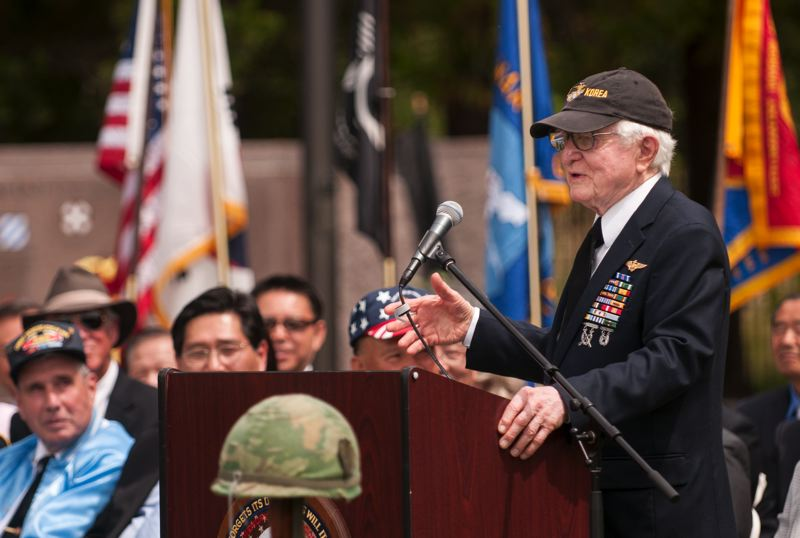 by: SPOKESMAN PHOTO: JOSH KULLA - U.S. Marine Corps veteran and decorated aviator Drury Wood, now 91 years old, speaks June 21 at a commemoration of the start of the Korean War. Wood was given an award by the Korean Consul Chansik Yoon honoring an essay Wood wrote about his wartime experiences in Korea.