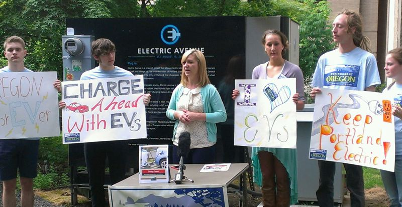 by: COURTESY ENVIRONMENT OREGON - The benefits of electric vehicles are expalined in a report released Thuesday during a press conference at Electric Avenue at Portland State Univeristy. Speakers included (center) Ashley Horvat, the State of Oregon Chief EV Officer.