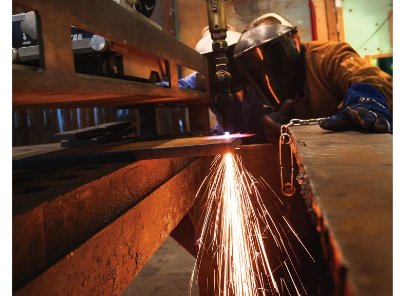by: TRIBUNE PHOTO: JOHN M. VINCENT - Using torches to cut metal is one of the skills taught at PCCs Swan Island Training Center. The school is located in the Vigor Industrial Portland shipyard.