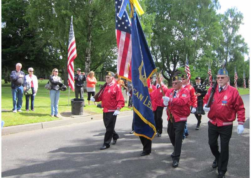 by: BARBARA SHERMAN - RED, WHITE AND BLUE ON PARADE - The Tigard American Legion Post 158 Color Guard presents the colors at the beginning of the Memorial Day ceremony.