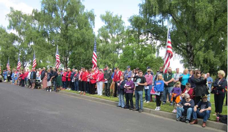 by: BARBARA SHERMAN - COLORFUL CROWD â€' The crowd gathered in Crescent Grove Cemetery along the main road  watches for the Tigard American Legion Post 158 Color Guard to present the colors to kick off the Memorial Day ceremony.