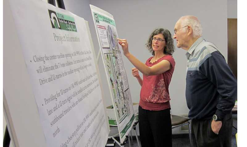 by: BARBARA SHERMAN - EXPLAINING THE DETAILS - Lili Boicourt with ODOT talks to a man at the June 12 open house at King City City Hall about the 99W improvement project.