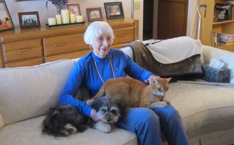 by: BARBARA SHERMAN - FURRY FRIENDS - When not hitting the books while earning her degrees, Velda Metelmann enjoys the company of her dog Suzie and cat Whisper in her King City home.