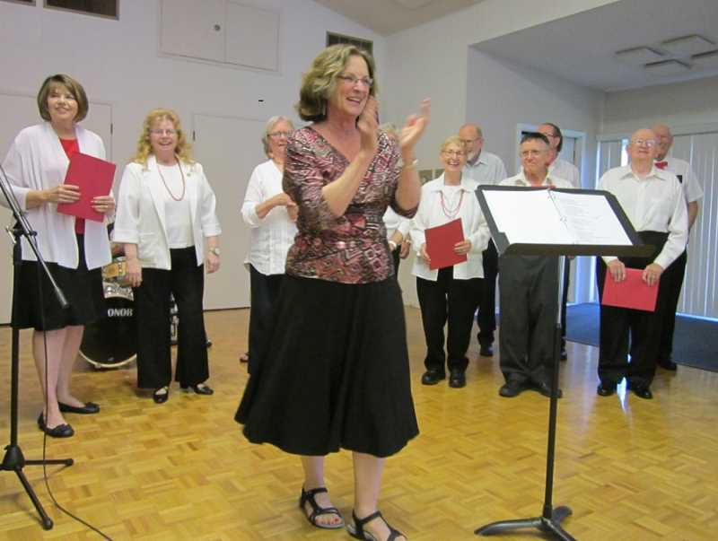 by: BARBARA SHERMAN - TALENTED IN MANY AREAS - Jo Ann Brinkman leads the King City Music Club Chorus during rehearsals and at the open mics, including the June 2 event shown in this photo.