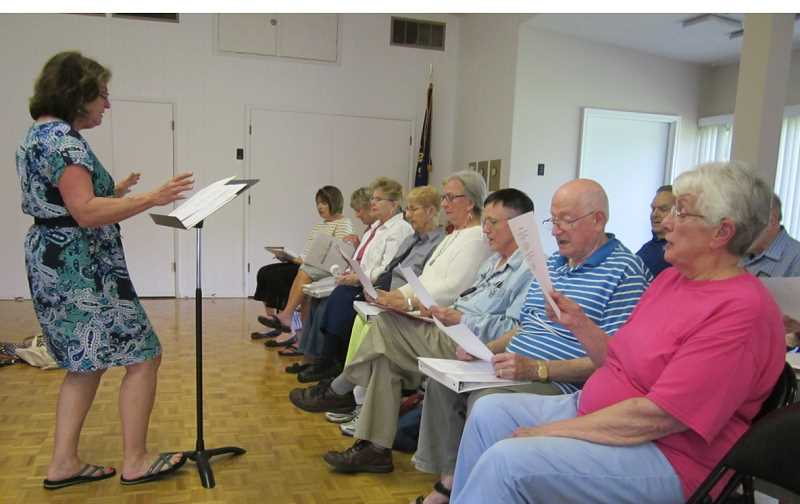 by: BARBARA SHERMAN - LEARNING NEW SONGS IS PART OF THE FUN - Jo Ann Brinkmam (left) who has years of directing experience, has been leading the King City Music Club Chorus, which includes Lynn Turner (right), for about a year.
