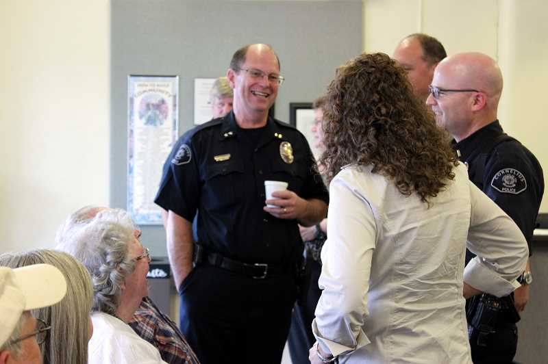 by: NEWS-TIMES PHOTO: KATE STRINGER - Citizens and city leaders chat with Summers last week at a farewell bash to celebrate a momentous last year and a half.