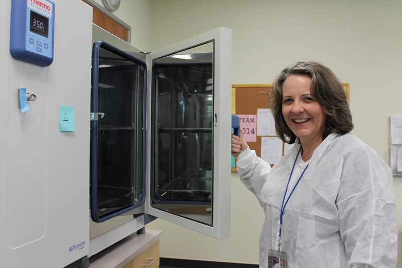 by: SPOKESMAN PHOTO: KATE HOOTS - Assistant Professor Dawn Taylor shows off the equipment available for high school students to use in the laboratory when they enroll in the medical detectives course at Oregon Tech this summer.