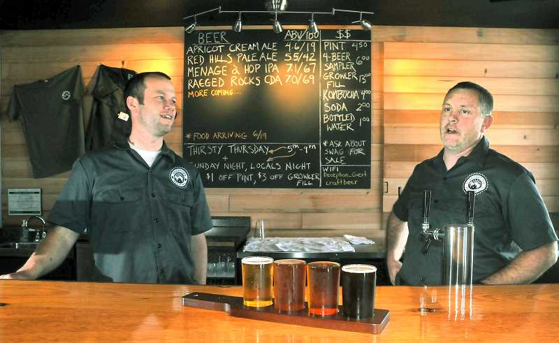 by: GARY ALLEN - New business - Ben Hoffman (left) and Brian Wheatley recently opened Deception Brewing Company in Dundee. The pair started the business after discussing the idea since attending Tigard High School.