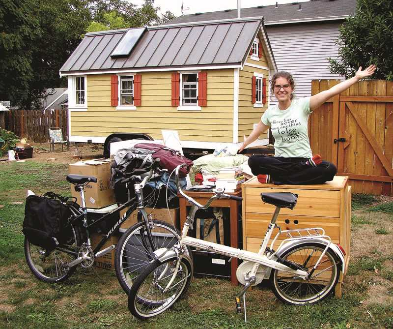 by: COURTESY OF BRITTANY YUNKER - Two hundred possessions and bikes are two of them? Living light advocate Lina Menard says she doesn't own a car, so she uses one bike for grocery hauling and the second for cruising around town.