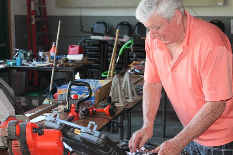 by: TIDINGS PHOTO: PATRICK MALEE - Wall formed Tools for Troops with Lake Oswego resident Patt Bilow, a 20-year Coast Guard veteran. The first tool giveaway took place June 11 at the Robinwood Community Center.