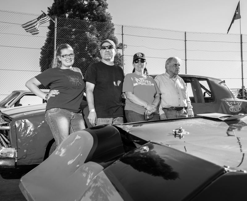 by: NEWS-TIMES PHOTO: CHASE ALLGOOD - Four generations of the McGrotty family - (from left) Ashley Vandecoevering, Michael Vandecoevering, Alice Losli and Bob McGrotty - pose before a special race at Sunset Speedway.