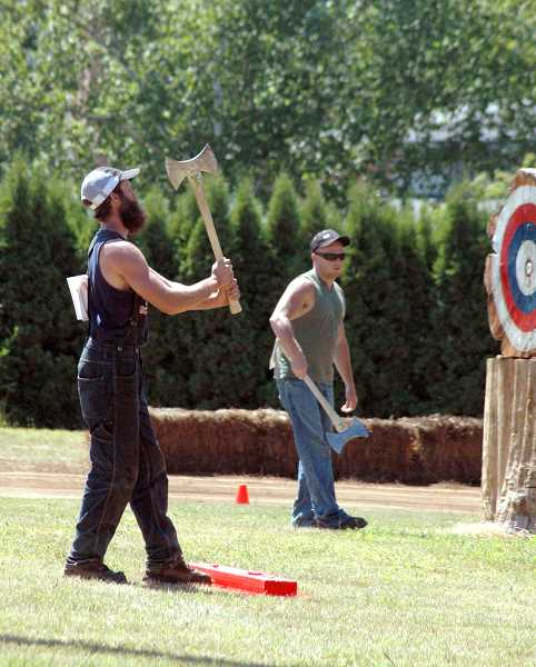by: ISABEL GAUTSCHI - The ax throwing event is back for this year's Timber Festival.