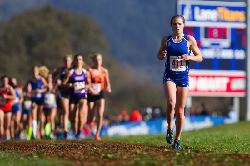 by: COURTESY OF JOHN LARIVIERE - Grant High's Ella Donaghu takes the lead in the Class 6A cross-country championships in Eugene, early in what was an impressive sophomore year for her.