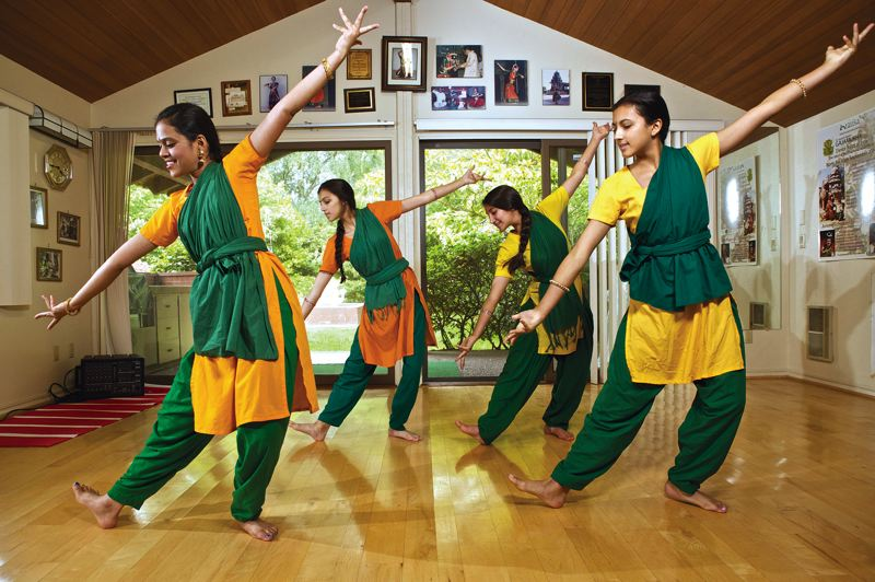 by: TIMES PHOTO/JAIME VALDEZ - Traditional Indian dance students, from left, Snigdha Malladi, Maelle Hily, Aanya Khaira and Enora Hily rehearse a routine at the Natya Dance Academy studio near Bethany. They're preparing for their individual Arangetram performances this summer, which start on Sunday with Khaira's recital at the Portland Center for the Performing Arts.