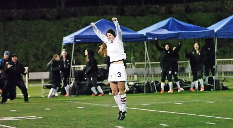 by: DAN BROOD - GOAL TIME -- Tualatin's Jill Farley jumps into the air after scoring a goal in the state title game.