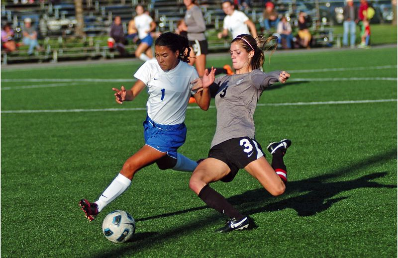 by: DAN BROOD - PLAYING HARD -- Tualatin's Jill Farley (right) went all out for the Timberwolves during her senior season.