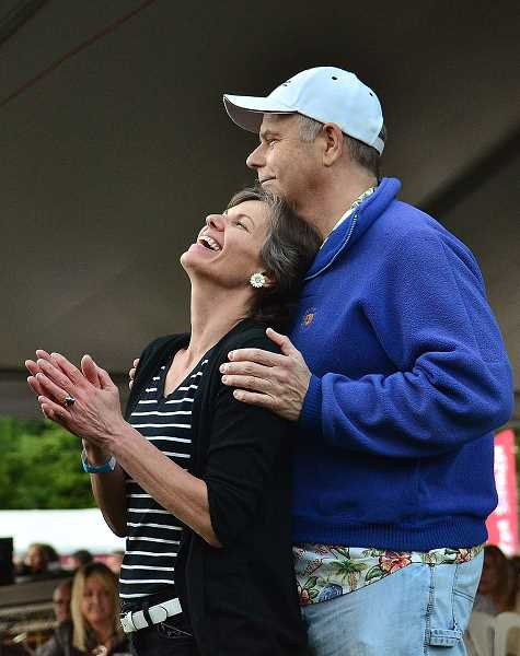 Sylvia Ritchie and Kurt Doctor listen to the music of Quarterflash during Friday nights concert.