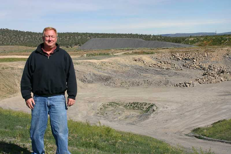 by: JASON CHANEY - Crook County Landfill Manager Leroy Gray stands alongside cell five, which is currently under construction.