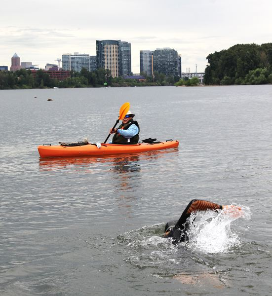 by: OUTLOOK PHOTO: CARI HACHMANN - Double cancer patient Dean Hall, 54, began his 2.5-mile swim into Portland City Center on Wednesday evening, June 25.