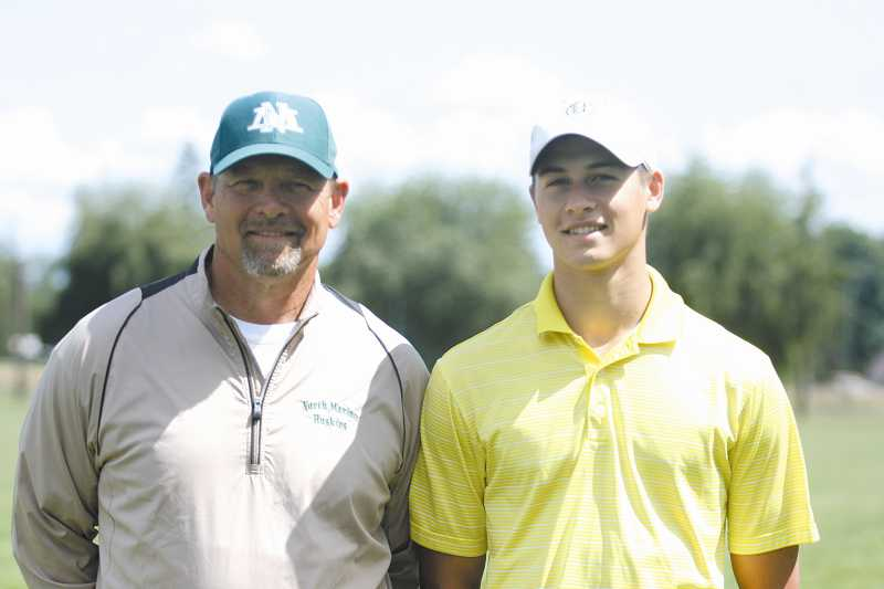 by: PHIL HAWKINS - North Marion golf coach Bill Crumley and golfer Ben Crumley left North Marion together.